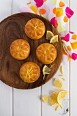 Mini lemon cakes on a wooden plate