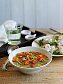 Vegetable soup with peppers, carrots and peas
