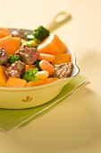 Sauteed sirloin steak with carrots, broccoli and pumpkin