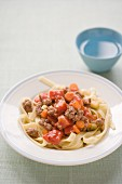 Tagliatelle with minced beef, tomatoes, carrots and courgettes