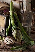 A rustic, nostalgic arrangement featuring fresh artichokes
