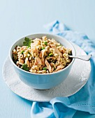 Salmon pilau with bacon, peas and herbs