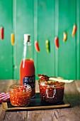 Hot chilli sauce, sweet chilli jam and fresh chilli and garlic paste