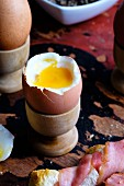 Soft boiled eggs with bacon-wrapped toast