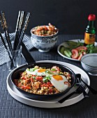 Fried rice with cauliflower and fried eggs
