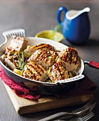Grilled pork fillets with a chilli and garlic marinade garnished with dill