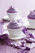 Purple cupcakes decorated with sugar flowers