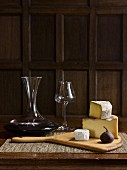 Red wine, various types of cheese and a fig