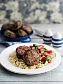 Lentil and Quorn burgers with curry on a bed of couscous