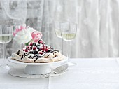 Pavlova with chocolate and raspberries