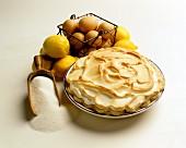 Lemon meringue pie with ingredients (sugar, eggs, lemons)