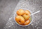 Lokma, a traditional Turkish street food (fried doughnuts with chopped pistachios)