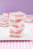 A stack of pink and white coconut ice
