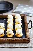Mini mince pies with ice cream on a tray