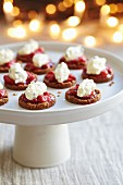 Oatcakes topped with tomato relish and cream cheese