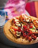 Greek style toast topped with tomatoes, oregano and feta cheese