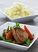 Pork fillets with tomatoes, courgettes and mashed potato