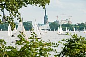 Sailors on the Outer Alster looking towards the city centre where the town hall and the Elbphilharmonie are located