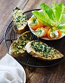 Salmon rolls with cream cheese and crostini topped with garlic and parsley oil