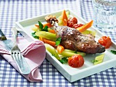 Chicken leg with celery, carrots and tomatoes