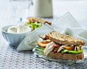 Rye bread sandwich with chicken and peppers