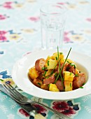 Sausages with potatoes and chives