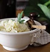Homemade sauerkraut in a white porcelain bowl