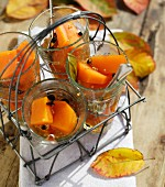 Spiced sweet and sour pickled pumpkin in glasses