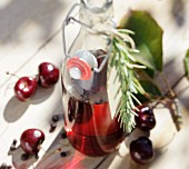 Homemade cherry vinegar with rosemary