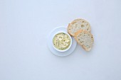 Fennel and lemon butter with ginger served with slices of white bread (seen from above)