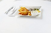 Fish with chips served in newspaper