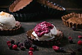 Homemade ice cream with frozen berries in chocolate tartlet bases