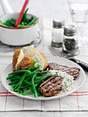 Beef steak with dill sauce, baked potatoes and green beans