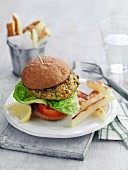 A vegetable burger with tomatoes and lettuce