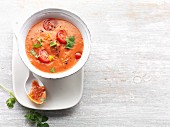 Cream of tomato soup with coriander, spring onions and chilli