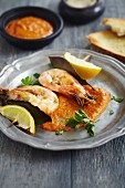 King prawns served with red pepper hummus