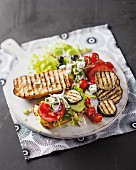 A sandwich with Greek salad ingredients and aubergines