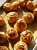 Profiteroles on a baking tray