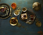 An arrangement of tea utensils and ingredients on a wooden table