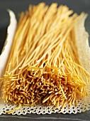 Dried spaghetti on a doily