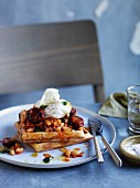 Wholemeal waffles with baked beans, chorizo and egg