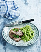 Grilled chops with a vegetable salad