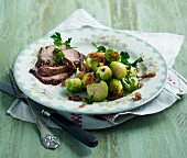 Roast lamb with Brussels sprouts and crispy ham