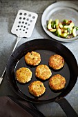 Fish cakes with an avocado and onion salad