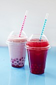 Fruit bubble tea with tapioca pearls in plastic cups