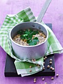 Chickpeas with parsley in a pan of water