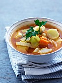 Clear fish soup with leek and carrots