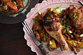 Roasted chicken drumsticks with carrots, lemons and pistachios