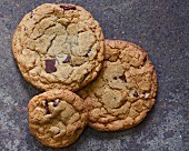 Three chocolate chip cookies (seen from above)