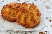 Two coconut macaroons on a plate